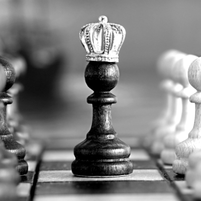 A chess pawn piece with a crown on the top - Writing award submissions - Etymon